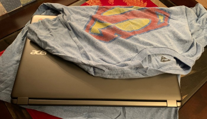Laptop covered in clothes for protection