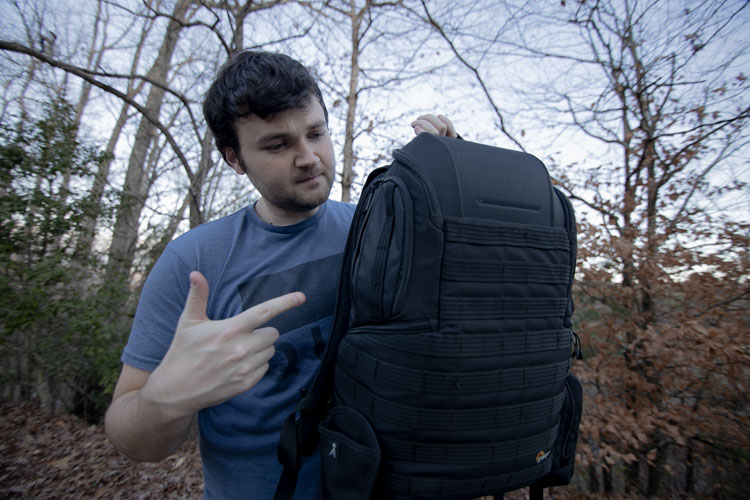 Patrick holding backpack with laptop inside